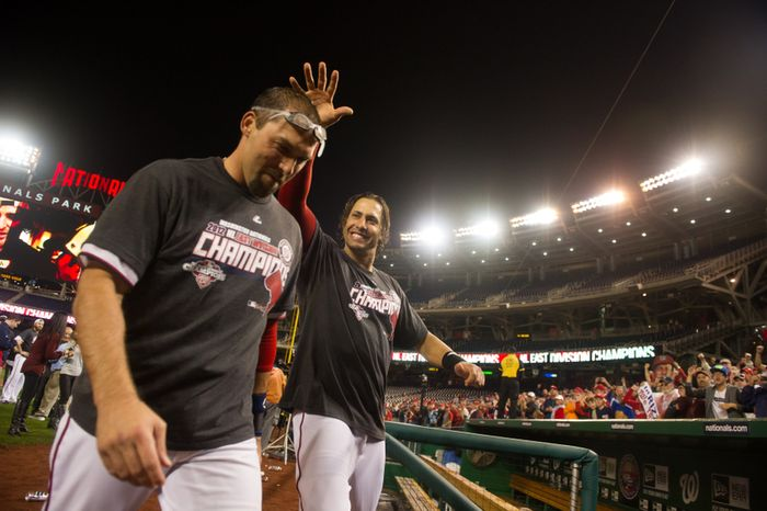 Washington Nationals left fielder Mark DeRosa (7), left, and Washington Nationals left fielder Michael Morse (38), center, heads to the locker room as the the Washington Nationals clinch the National League East at Nationals Park, sending them into the playoffs, Washington, D.C., Monday, October 1, 2012. (Andrew Harnik/The Washington Times)