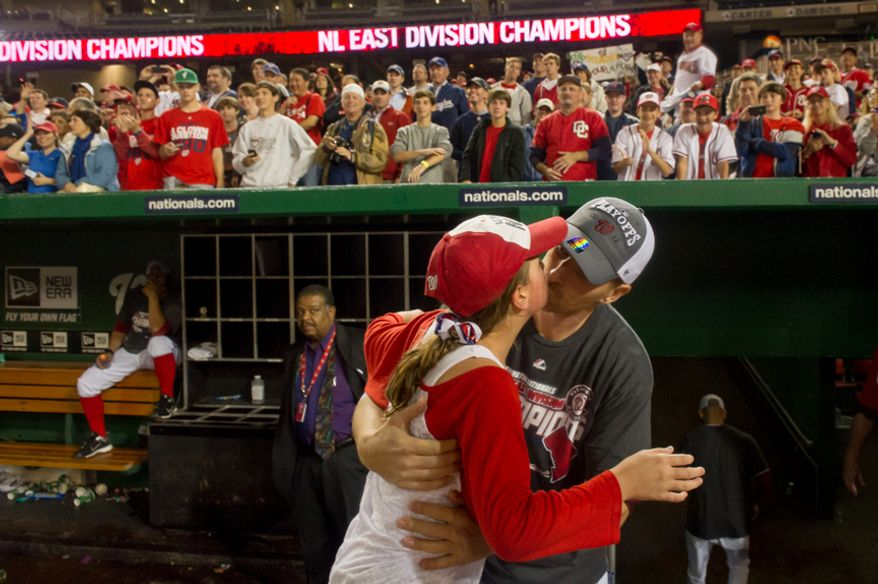 Washington Nationals first baseman Adam LaRoche (25) kisses his daughter Montana as the Washington Nationals clinch the National League East at Nationals Park, sending them into the playoffs, Washington, D.C., Monday, October 1, 2012. (Andrew Harnik/The Washington Times)