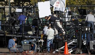 Television crews setup on a riser out side of the Magness Arena at the University of Denver in Denver,Tuesday, Oct. 2, 2012, where the first presidential debate between President Obama and Republican presidential candidate Mitt Romney is scheduled for Oct. 3. (AP Photo/Ed Andrieski)