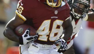 Washington Redskins running back Alfred Morris (46) slips by Tampa Bay Buccaneers defensive end Michael Bennett (71) during the first quarter of an NFL football game Sunday, Sept. 30, 2012, in Tampa, Fla. (AP Photo/Chris O'Meara)
