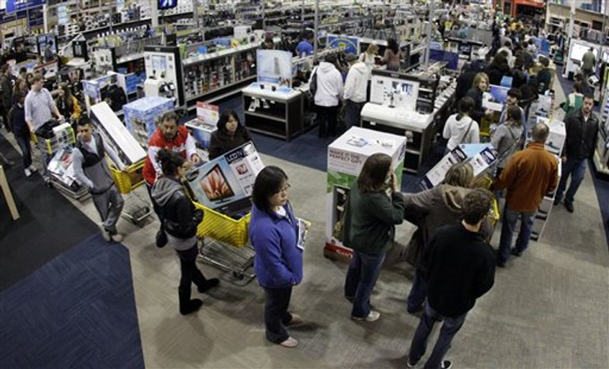 ** FILE ** In this Friday, Nov. 25, 2011, file photo, a checkout line winds through a Best Buy store as shoppers take advantage of a midnight Black Friday sale on Friday, Nov. 25, 2011, in Brentwood, Tenn. The National Retail Federation, the nation's largest retail trade group, said Tuesday, Oct. 2, 2012, that it expects sales during the winter holiday shopping period in November and December to rise 4.1 percent this year. (AP Photo/Mark Humphrey, File)