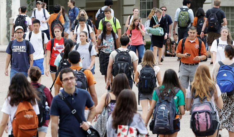 "Students walk through the University of Texas at Austin campus. The campus has one of the most-diverse student bodies in the country. Texas has maintained some use of affirmative action. It also has implemented a ""top 10 percent"" plan granting automatic admission to top high school students based on class rank and, as a result, its enrollment of minorities has risen overall since the late 1990s. (Associated Press)"