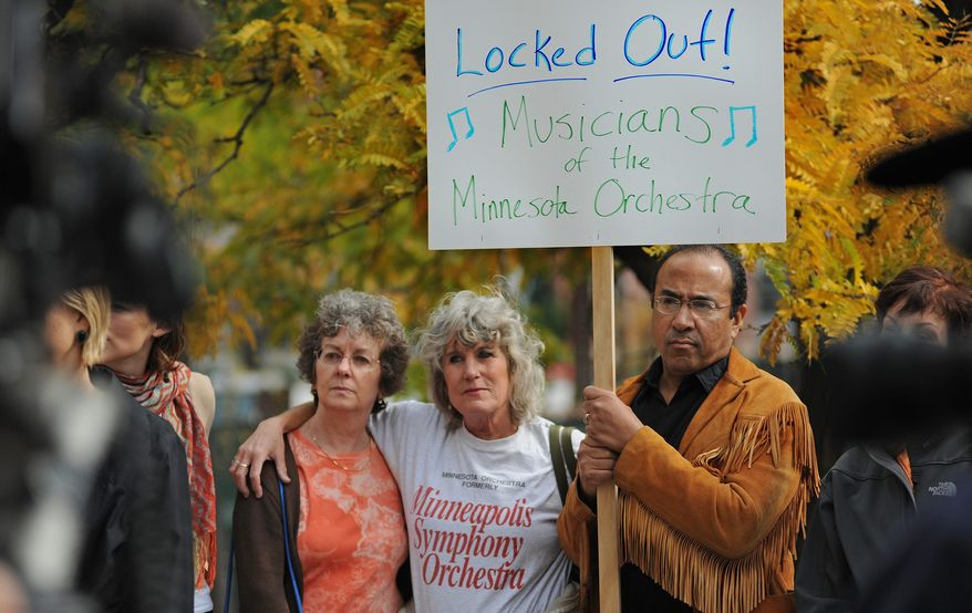 In this photo taken Monday Oct. 1, 2012, Minnesota Orchestra musicians locked out in contract dispute rally at 11th St and Nicollet Mall near Peavey Plaza In Minneapolis, Minn. The Minnesota Orchestra was called the world's greatest not long ago, welcome recognition for musicians outside a top cultural center. Now its members are locked out of Orchestra Hall, stuck in the same kind of labor-management battle recently afflicting teachers and football referees. (AP Photo/The Star Tribune, Richard Sennott)