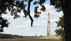 A drill rig helps bring much-needed jobs to Carrollton, Ohio. Carroll County boasts more active oil and gas wells than any other county in Ohio, and the tax dollars are flowing right along with the crude. (Associated Press)