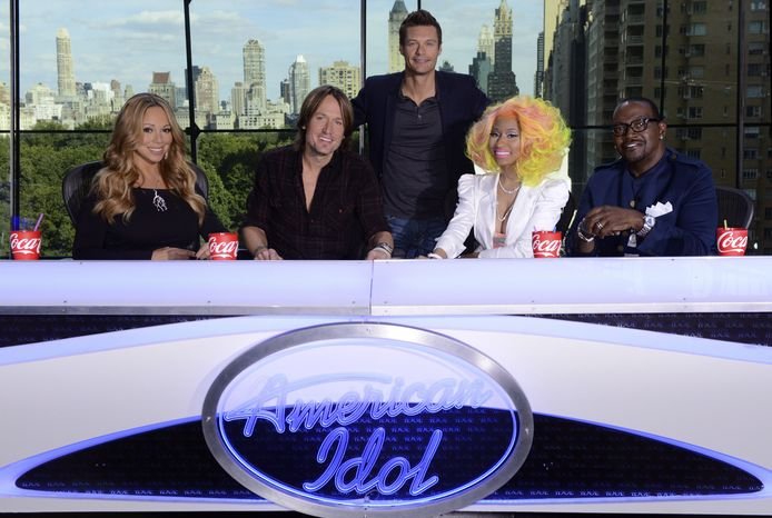 """American Idol"" host Ryan Seacrest (standing) poses with judges (from left) Mariah Carey, Keith Urban, Nicki Minaj and Randy Jackson on Sund"