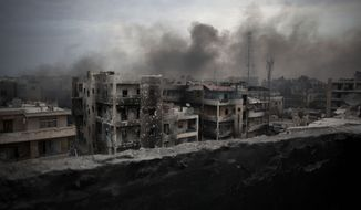 Smoke rises over the Saif Al Dawla district in Aleppo, Syria, on Tuesday, Oct. 2, 2012. (AP Photo/Manu Brabo)