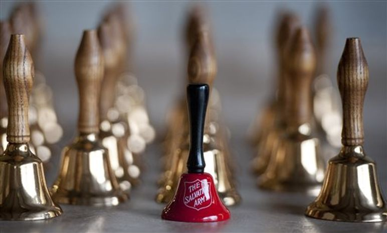 """A red Salvation Army bell sits on a table at a the temporary site of the Bevin Bros. manufacturing in East Hampton, Conn., Wednesday, Oct. 3, 2012. The 180-year-old New England company that made the tiny bell that tinkles every time an angel gets its wings in the holiday classic """"It's a Wonderful Life"""" is resuming production months after the factory was destroyed in a fire. The factory, which is now making bells for Salvation Army bell-ringers, is returning with government grants and private investment. (AP Photo/Jessica Hill)"""