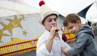 "Matthew Dovi, 4, of McLean, Va., who is blind, feels the chest of Pinot the clown, aka Mark Jaster, as he blows a whistle outside the Big Apple Circus tent before a special ""Circus of the Senses"" performance on Wednesday, Oct. 3, 2012 in Sterling, Va.  (Barbara L. Salisbury/The Washington Times)"
