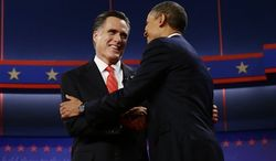 President Barack Obama and Republican presidential candidate and former Massachusetts Gov. Mitt Romney meet on stage at the start of the first presidential debate in Denver, Wednesday, Oct. 3, 2012. (AP Photo/Charles Dharapak)