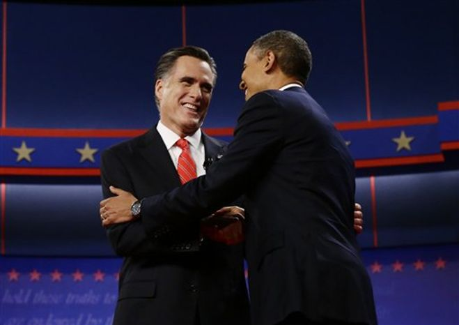 President Barack Obama and Republican presidential candidate and former Massachusetts Gov. Mitt Romney meet on stage at the start of the first