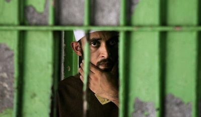 A Palestinian prisoner is seen at the Hamas-controlled Saraya Prison in Gaza City, Gaza Strip, in July 2007. (AP Photo/Kevin Frayer)