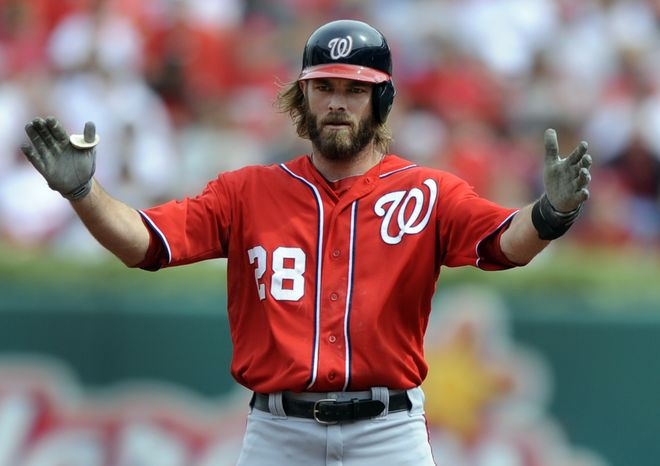 Washington Nationals' Jayson Werth celebrates after hitting a double during the first inning of a baseball game against the St. Louis Cardinals Sunday, Sept. 30, 2012, in St. Louis. (AP Photo/Bill Boyce)