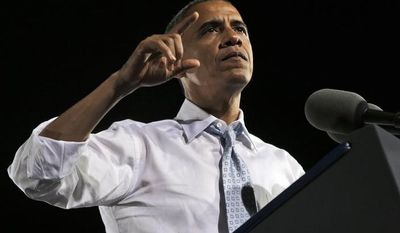 President Obama speaks Sept. 30, 2012, during a campaign event at Desert Pines High School in Las Vegas. (Associated Press)