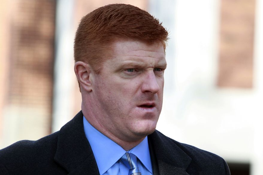 FILE - In this Jan. 25, 2012 file photo, former Penn State assistant football coach Mike McQueary arrives at the Pasquerilla Spiritual Center on the Penn State campus for the funeral service of former Penn State football coach Joe Paterno in State College, Pa. McQueary, the former Penn State graduate assistant who says he saw former assistant football coach Jerry Sandusky showering with a boy in 2001 and testified against him has sued the university for what he says is defamation and misrepresentation. His whistle-blower complaint was filed Tuesday, Oct. 2, 2012.  (AP Photo/Jacqueline Larma, File)