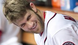 ** FILE ** Washington Nationals Bryce Harper smiles as he sits in the dugout during a baseball game (AP Photo/Manuel Balce Ceneta)