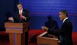 President Obama and Republican presidential nominee Mitt Romney participate Oct. 3, 2012, in the first presidential debate at the University of Denver in Denver. (Associated Press)