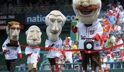 "This photo taken June 1, 2012 shows Teddy Roosevelt , left, crossing the finish line riding a Segway, defeating the other Presidents in the ""Presidents Race"" held between innings at the Washington Nationals baseball game at Nationals Park in Washington. (AP Photo/John McDonnell, The Washington Post)WIRES OUT MAGS OUT TV OUT NEW YORK TIMES WASHINGTON TIMES OUT NO TRADES NO SALES MANDATORY CREDIT"
