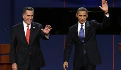 Republican presidential nominee Mitt Romney and President Obama wave to the audience during the first presidential debate at the University of Denver on Wednesday, Oct. 3, 2012, in Denver. (AP Photo/Charlie Neibergall)
