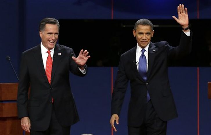 Republican presidential nominee Mitt Romney and President Obama wave to the audience during the first presidential debate at the University of Denver on Wednesday, Oct. 3, 2012, in