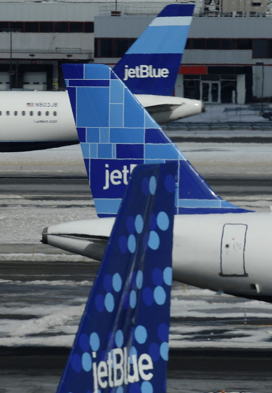 **FILE** JetBlue planes depart and arrive at JFK International Airport in New York on Feb. 18, 2007. (Associated Press)