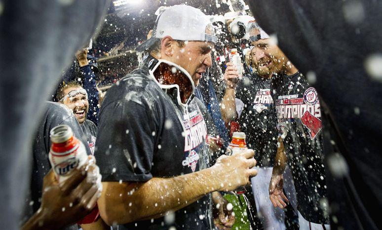 Ryan Zimmerman celebrates after the Nationals clinched the National League East. (Andrew Harnik/The Washington Times)