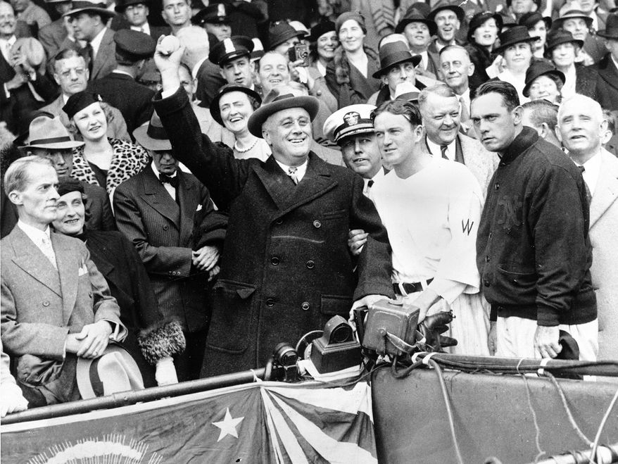 President Franklin D. Roosevelt threw out the ceremonial first pitch at Griffith Stadium before Game 3 of the 1933 World Series between Washington and the New York Giants as Senators manager Joe Cronin (third from right) and New York counterpart Bill Terry (second from right) look on. The Fall Classic was a national obsession, as evidenced by a scoreboard outside a building in Norfolk, Va., that tracked the developments of Game 1. The Giants won the World Series 4-1, and it would be 79 years before Washington would experience postseason baseball again. (Associated Press)