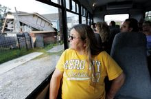 Kathy Stewart, of Enfield, Ill., looks at a wrecked house as her tour bus passes through the 9th Ward part of New Orleans. Residents and city officials are pushing back against tour companies that take out-of-towners into the Lower 9th Ward, the neighborhood devastated by Hurricane Katrina flooding. (Associated Press)