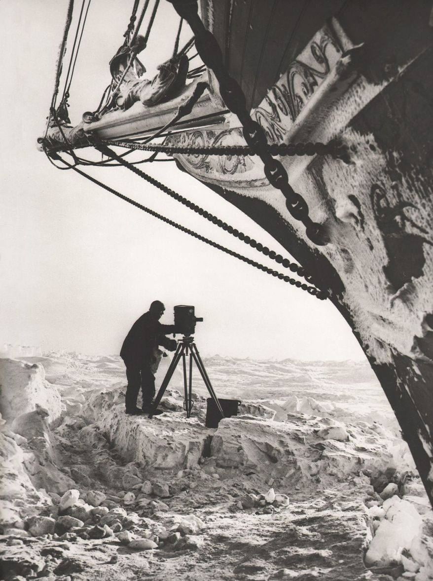 Photographer Frank Hurley had to work in extreme cold with a camera on a tripod and glass negative plates.