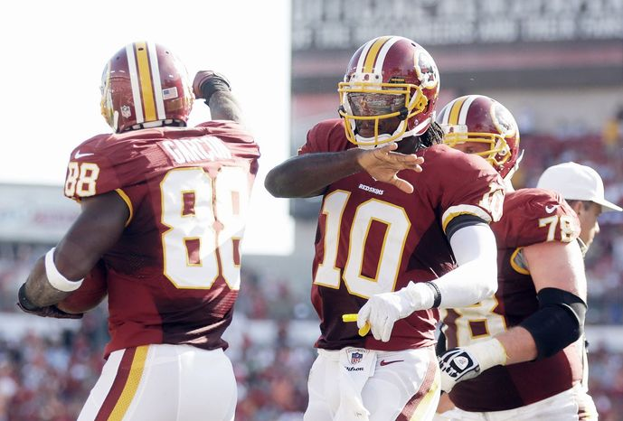 Wide receiver Pierre Garcon (left) and Robert Griffin III celebrate a touchdown against Tampa Bay. Garcon played 49 of 73 snaps against the Buccaneers and caught one pass for 20 yards as he continues to recover from a foot injury. (Associated Press)