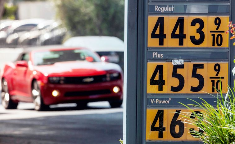 Motorists drive past a gas station in Los Angeles on Thursday. Motorists in California paid an average of $4.232 per gallon Wednesday. That i