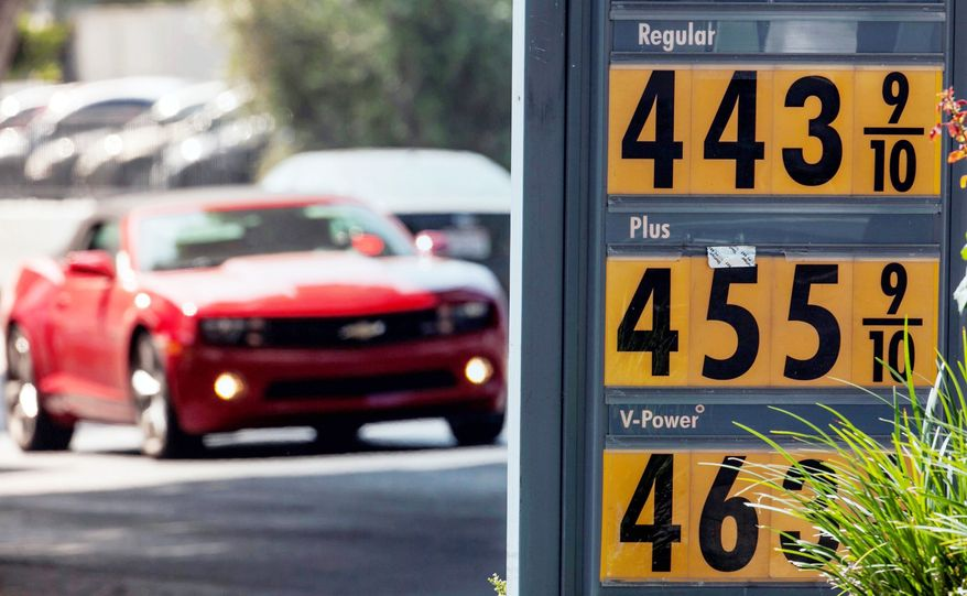 Motorists drive past a gas station in Los Angeles on Thursday. Motorists in California paid an average of $4.232 per gallon Wednesday. That is 45 cents higher than the national average, exceeded only by Hawaii among the 50 states. (Associated Press)