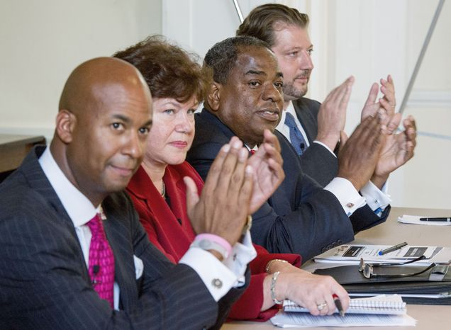 D.C. Council incumbents Michael A. Brown (left), an independent, and Vincent B. Orange (second from left), a Democrat, attend a debate with challengers David Grosso, an independent, and Mary Brooks Beatty, a Republican, on Thursday. (Andrew Harnik/The Washington Times)