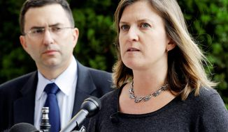 Dr. Lucy Wilson, with fellow Maryland public health official Josh Sharfstein, holds a news conference to explain response efforts to an outbreak of meningitis that may be linked to steroid injections. (Associated Press)