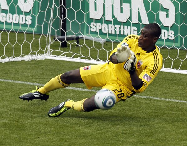 DC United goalkeeper Bill Hamid blocks the second of three penalty shots during the second half of their MLS soccer game against the Portland Timbers in  Portland, Ore., Sunday, May, 29, 2011.  Hamid stopped two of three penalty shots in regulation time as they beat the Timbers 3-2. (AP Photo/Don Ryan)
