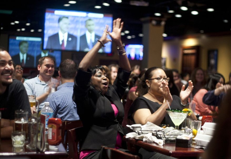 Yema Nelson, of Arlington, Va., reacts as she watches the first presidential debate between President Obama and Republican nominee Mitt Romney during a watch party put on by the Arlington Young Democrats and the Arlington County Democratic Committee at Bailey's Pub in Ballston Common Mall, Ballston, Va., Wednesday, Oct. 3, 2012. (Craig Bisacre/The Washington Times)