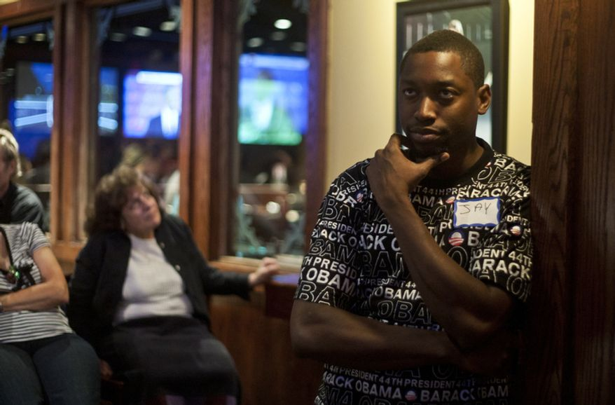 Jay Williams of Arlington, Va., watches the first presidential debate between President Obama and Republican nominee Mitt Romney during a watch party put on by the Arlington Young Democrats and the Arlington County Democratic Committee at Bailey's Pub in Ballston Common Mall, Ballston, Va., Wednesday, Oct. 3, 2012. (Craig Bisacre/The Washington Times)