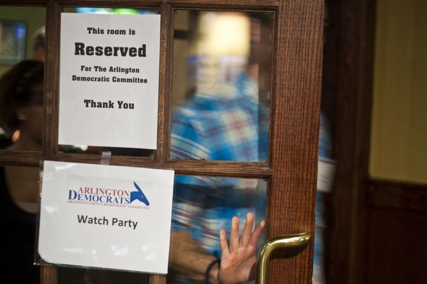 More than 100 viewers attended a watch party put on by the Arlington Young Democrats and the Arlington County Democratic Committee at Bailey's Pub in Ballston Common Mall, Ballston, Va., Wednesday, Oct. 3, 2012. (Craig Bisacre/The Washington Times)
