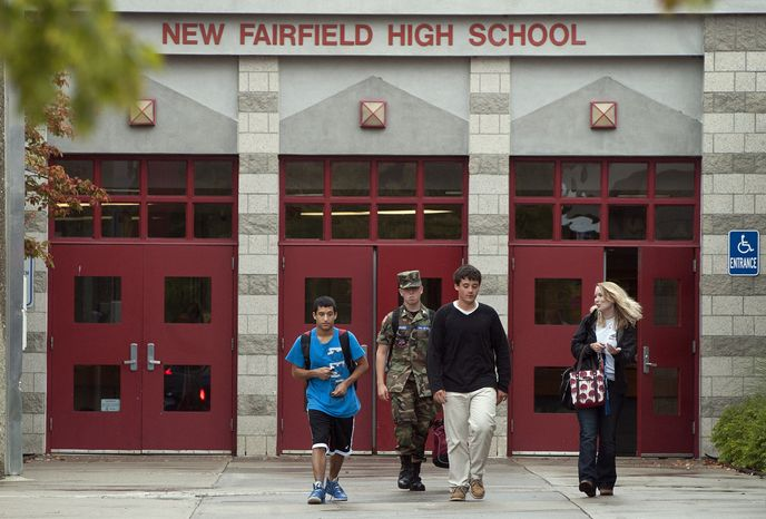 Students leave New Fairfield High School in New Fairfield, Conn., on Sept. 28, 2012. Tyler Giuliano, a student involved in Civil Air Patrol at the school, was killed by his father, Jeffrey Giuliano, during what appeared to be an attempted burglary early Thursday morning. Giuliano fatally shot a masked teenager in self-defense, then discovered that he had killed his son, state police said. (Associated Press)