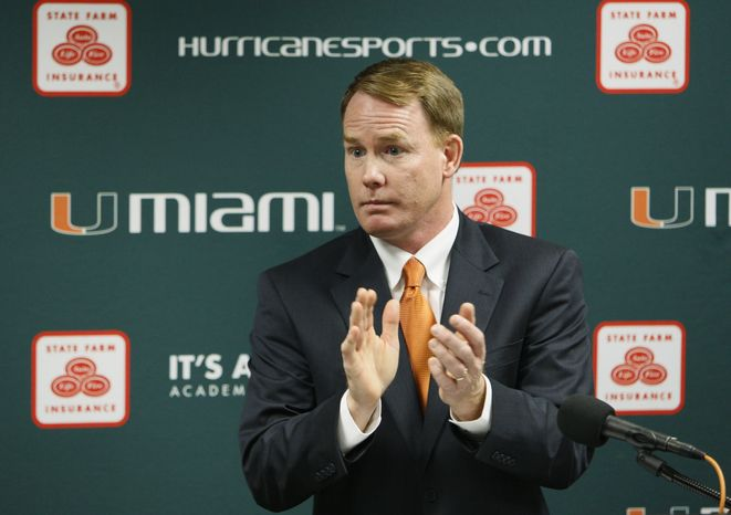 FILE - This April 19, 2011 file photo shows Miami athletic director Shawn Eichorst clapping as he speaks during a news conference in Coral Gables, Fla. A person with knowledge of the situation says that Eichorst has resigned, less than 18 months after he began leading the Hurricanes' troubled department. The person spoke to The Associated Press Thursday, Oct. 4, 2012,  on condition of anonymity because the university had not publicly announced Eichorst's decision, and that universi