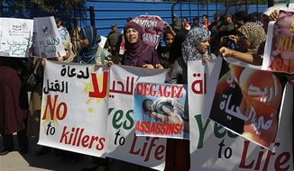 """Moroccan women protest the scheduled arrival of a Dutch ship advocating safe and legal abortions in Smir, Morocco Thursday oct 4 2012. Their signs read """"no to abortion."""" Moroccan authorities sealed a port where a Dutch abortion ship was set to arrive , while demonstrators protested against its arrival . (AP Photo/Paul Schemm)."""