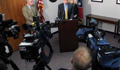 ** FILE ** In this Tuesday, Oct. 2, 2012, photo, Dr. David Reagan, chief medical officer for the Tennessee Department of Health, center, and Dr. Marion Kayiner talks with local and national media about an outbreak of fungal meningitis infections that have already killed two and sickened 13 others in Nashville, Tenn. (AP Photo/The Tennessean, Shelley Mays)