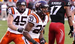 Virginia Tech's Michael Holmes (20) reacts to his fourth quarter running touchdown that gave them the lead 17-13 against Cincinnati during their NCAA College football game, Saturday, Sept. 29, 2012, in Landover, Md. Cincinnati defeated Virginia Tech 27-24. (AP Photo/Richard A. Lipski)