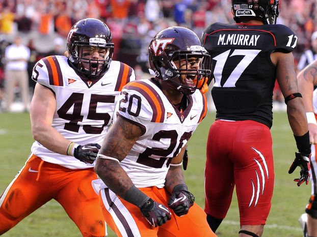 Virginia Tech's Michael Holmes (20) reacts to his fourth quarter running touchdown that gave them the lead 17-13 against Cincinnati during their NCAA College football game, Saturday, Sept. 29, 2012, in Landover, Md. Cincinnati defeated V
