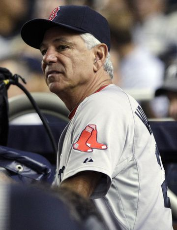 Boston Red Sox manager Bobby Valentine watches his team play the New York Yankees during the fourth inning of a baseball game, Wednesday, Oct. 3, 2012, i