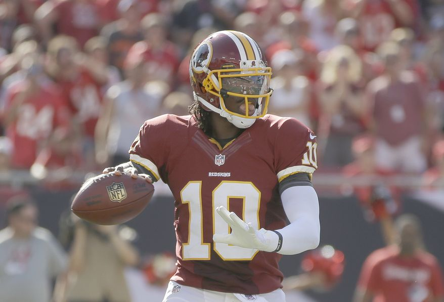 Washington Redskins quarterback Robert Griffin III (10) looks downfield for a receiver during an NFL game between the Redskins and the Tampa Bay Buccaneers.  The Redskins defeated the Buccaneers 24-22 Sunday, Sept. 30, 2012, in Tampa, Fla.  (AP Photo/Margaret Bowles)