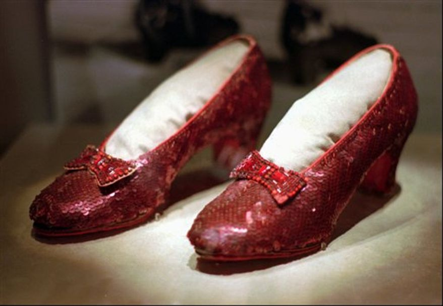 "** FILE ** In this April 10, 1996, file photo, the ruby slippers worn by Judy Garland in the 1939 film ""The Wizard of Oz"" are shown on display during a media tour of the ""America's Smithsonian"" exhibition in Kansas City, Mo. The ruby slippers are leaving the U.S. on their first international journey to London's Victoria and Albert Museum. (AP Photo/Ed Zurga)"
