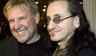 ** FILE ** Alex Lifeson, left, and Geddy Lee of the rock band Rush arrive for the Canadian Music Industry Awards in Toronto, in this Thursday, March 8, 2007, file photo. Rush is among the group of first-time nominees for the Rock and Roll Hall of Fame. (AP Photo/CP, Frank Gunn, File)