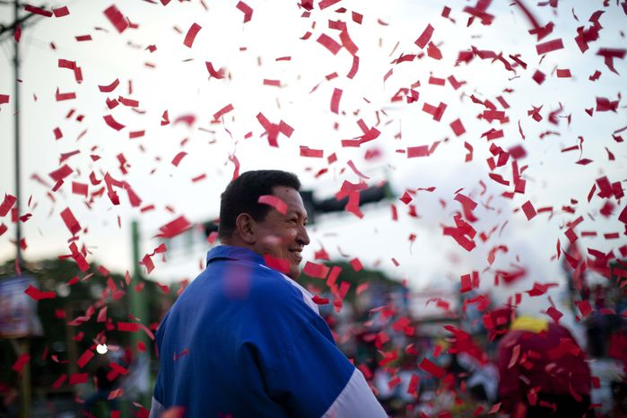 Venezuela's President Hugo Chavez smiles Oct. 3, 2012, during a campaign rally in Valencia, Venezuela. Chavez is running for re-election against opposition candidate Henrique Capriles in presidential elections on Oct. 7. (Associated Press)