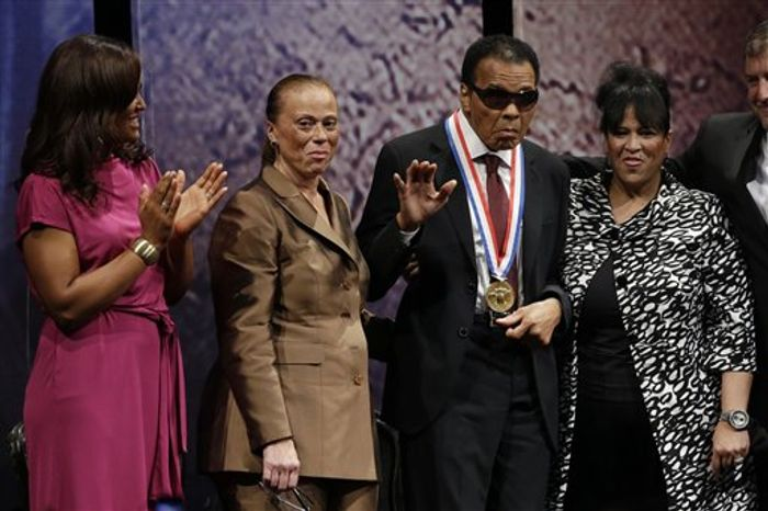 ** FILE ** Retired boxing champion Muhammad Ali, center, stands alongside his daughter, Laila Ali, left, wife Lonnie Ali, and his sister-in-law Marilyn Williams, right, after receiving the Liberty Medal during a ceremony at the National Constitution Center, Thursday, Sept. 13, 2012, in Philadelphia. The honor is given annually to an individual who displays courage and conviction while striving to secure liberty for people worldwide. (AP Photo/Matt Rourke)
