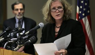 Dr. Madeleine Biondolillo, director of the Massachusetts Bureau of Healthcare Safety, answers a reporter's question on Thursday, Oct. 4, 2012, during a news conference in Boston regarding a meningitis outbreak linked to medicine from a Massachusetts specialty pharmacy. At rear left is Dr. Al DeMaria, the state epidemiologist. (Associated Press)